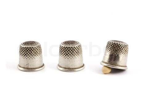2818401-729185-thimble-and-pea-isolated-on-white-background